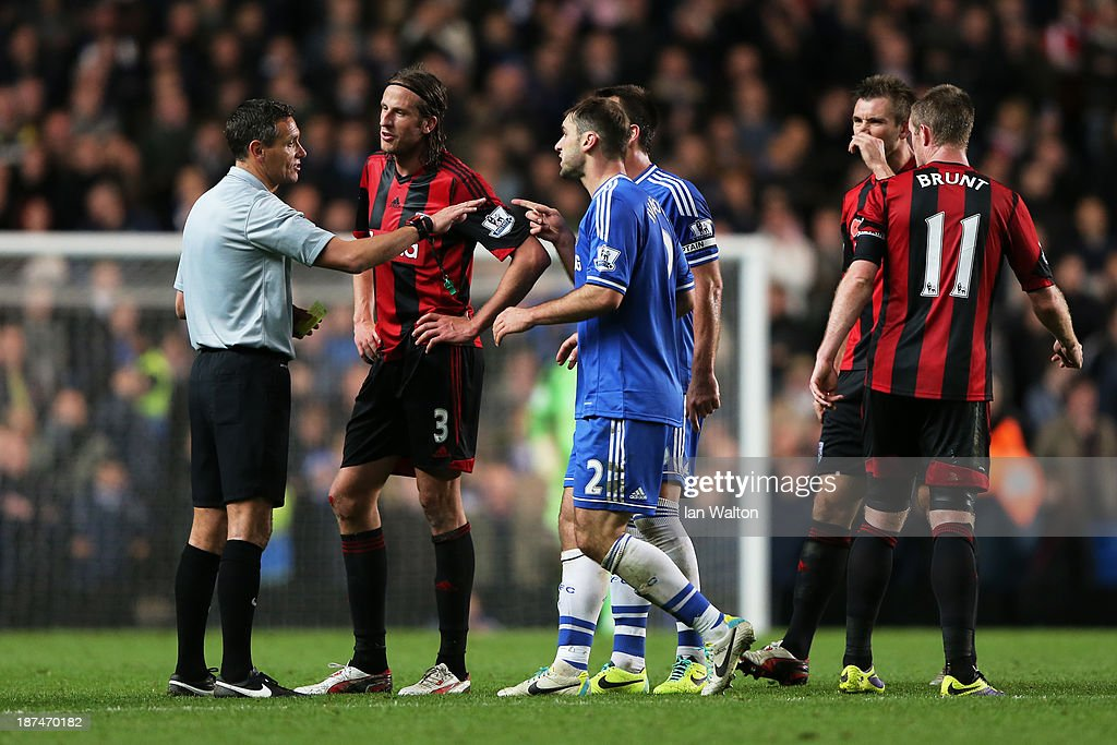 Referee Andre Marriner is surrounded by players after he awards a late penalty to Chelsea during the Barclays Premier League match between Chelsea and West Bromwich Albion at Stamford Bridge on November 9, 2013 in London, England.