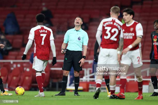 Referee Andre Marriner laughs out loud during the Premier League match between Arsenal and Crystal Palace at Emirates Stadium on January 14, 2021 in...