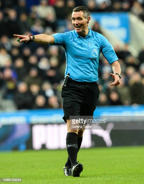 Referee Andre Marriner points during the Premier League match between Newcastle United and Manchester United at St James Park on January 02 2019 in...