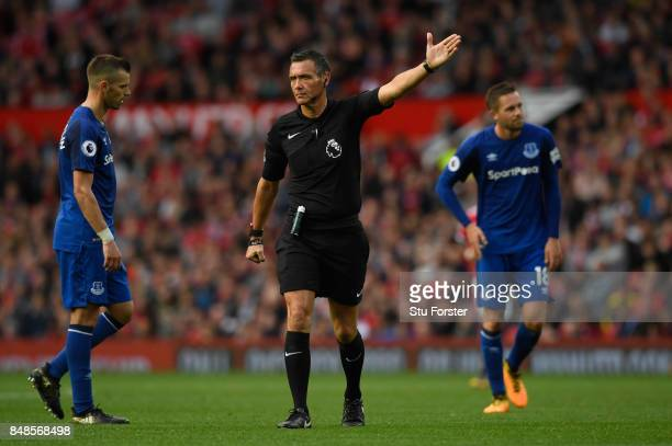 Referee Andre Marriner reacts during the Premier League match between Manchester United and Everton at Old Trafford on September 17 2017 in...
