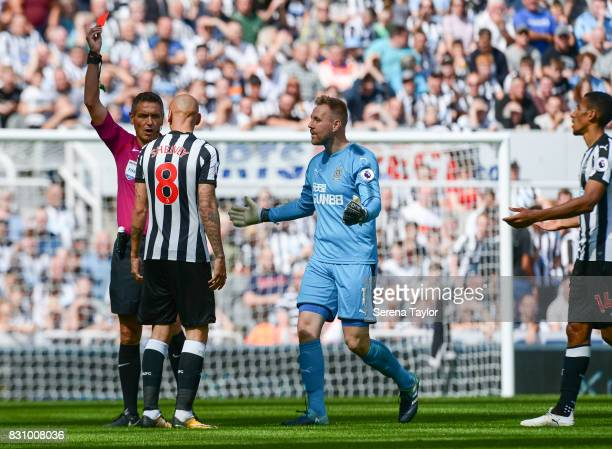 Referee Andre Marriner shows Jonjo Shelvey of Newcastle United a red card during the Premier League Match between Newcastle United and Tottenham...