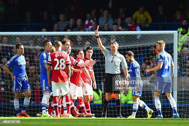 Referee Andre Marriner shows Kieran Gibbs of Arsenal a red card during the Barclays Premier League match between Chelsea and Arsenal at Stamford...