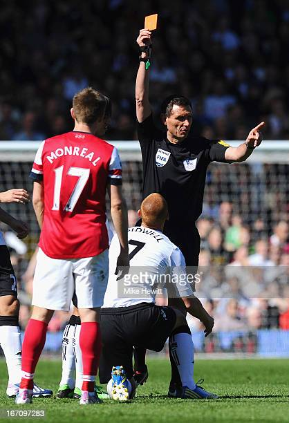 Referee Andre Marriner shows Steve Sidwell of Fulham a red card and sents him off after a tackle on Mikel Arteta of Arsenal during the Barclays...