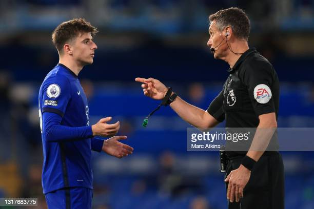 Referee Andre Marriner speaks with Mason Mount of Chelsea during the Premier League match between Chelsea and Arsenal at Stamford Bridge on May 12,...