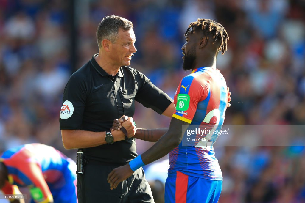 Referee Andre Marriner with Pape Soure of Crystal Palace during the Pre-Season Friendly between Crystal Palace and Toulouse at Selhurst Park on August 4, 2018 in London, England.