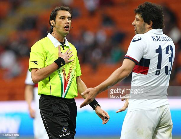 Referee Andrea Gervasoni disputes a decision with Kakha Kaladze of Genoa CFC during the Serie A match between AC Milan and Genoa CFC at Stadio...