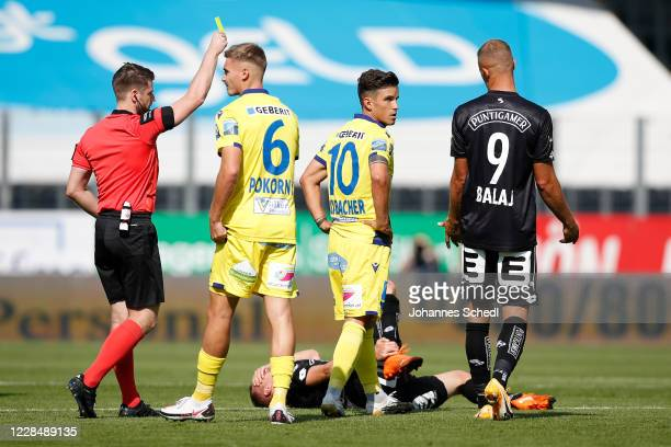 Referee Andreas Heiss, Peter Pokorny and Daniel Luxbacher of St. Poelten and Bekim Balaj of Sturm Graz during the tipico Bundesliga match between...