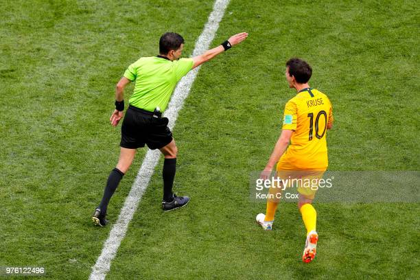 Referee Andres Cunha awards a penalty after consulting a VAR review as Robbie Kruse of Australia protests the decision during the 2018 FIFA World Cup...