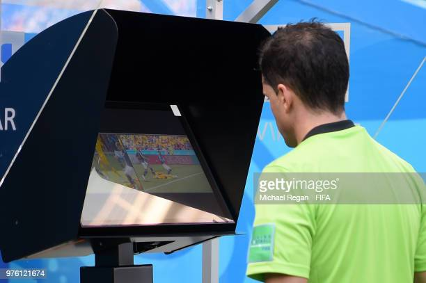 Referee Andres Cunha reviews the VAR footage, before awarding France a penalty during the 2018 FIFA World Cup Russia group C match between France and...