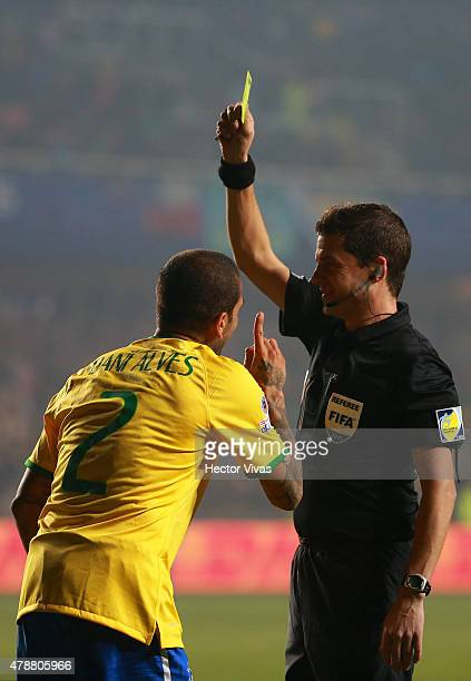 Referee Andres Cunha shows a yellow card to Dani Alves of Brazil during the 2015 Copa America Chile quarter final match between Brazil and Paraguay...