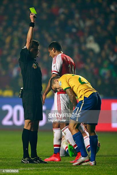 Referee Andres Cunha shows a yellow card to Pablo da Silva of Paraguay during the 2015 Copa America Chile quarter final match between Brazil and...