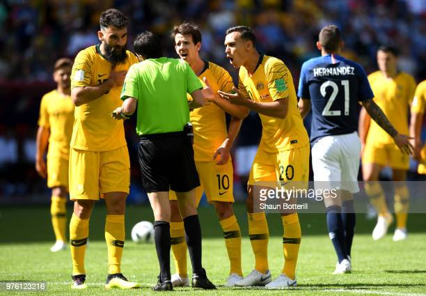 Referee Andres Cunha speaks with Mile Jedinak Robbie Kruse and Trent Sainsbury of Australia after concedoing a penalty to France during the 2018 FIFA...