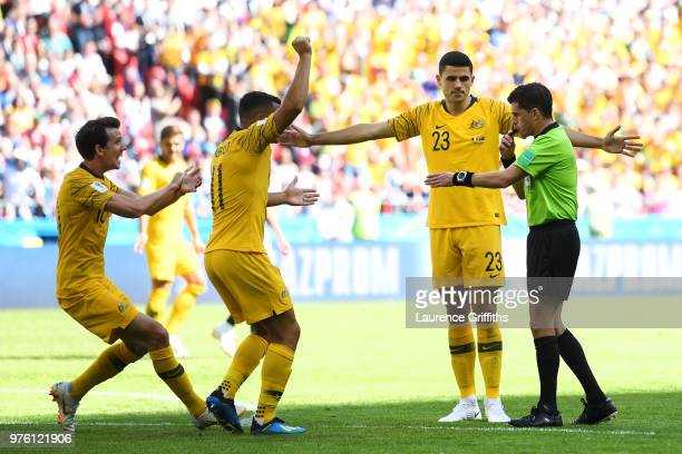 Referee Andres Cunha speaks with Robbie Kruse Andrew Nabbout and Tom Rogic of Australia during the 2018 FIFA World Cup Russia group C match between...