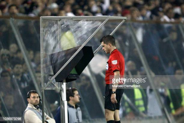 Referee Andres Cunha watches the actions with Var system during a quarter final first leg match between Colo Colo and Palmeiras as part of Copa...