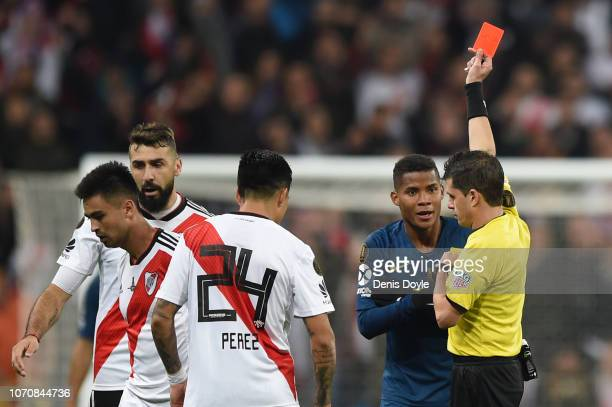 Referee Andres Ismael Cunha Soca shows Wilmar Barrios of Boca Juniors a red card during the second leg of the final match of Copa CONMEBOL...