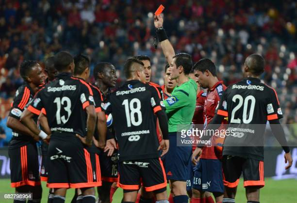 Referee Andres Rojas shows the red card to Jonny Mosquera of America de Cali during a match between Independiente Medellin and America de Cali as...