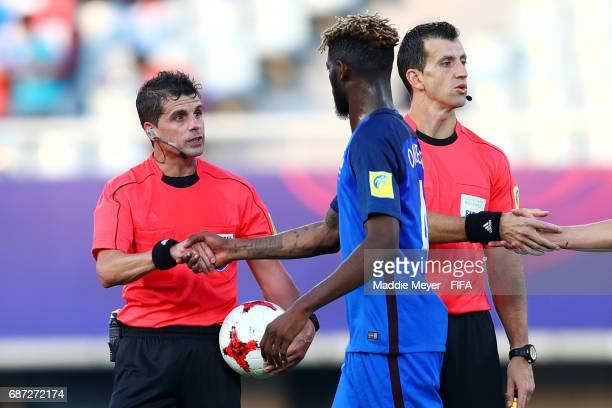 Referee Andrés Cunha shakes hands with Jerome Onguene of France after the FIFA U20 World Cup Korea Republic 2017 group E match between France and...