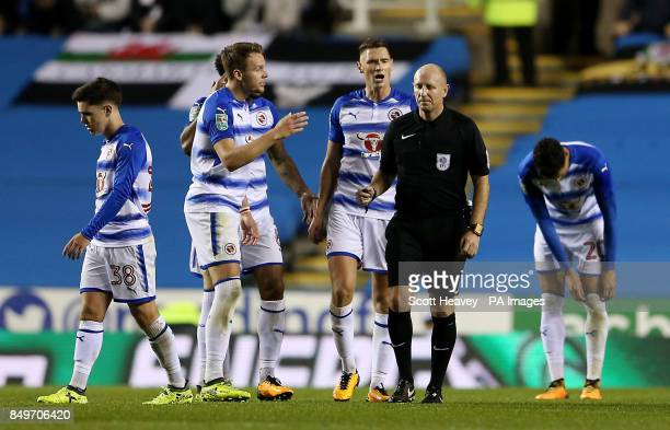 Referee Andy Davies is surrounded by Reading players after the second goal during the Carabao Cup third round match at the Madejski Stadium Reading