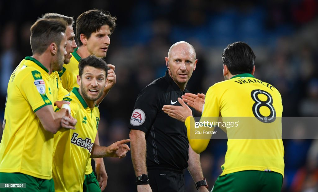 Referee Andy Davies reacts with the Norwich players during the Sky Bet Championship match between Cardiff City and Norwich City at Cardiff City Stadium on December 1, 2017 in Cardiff, Wales.