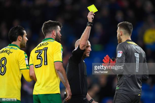Referee Andy Davies reacts with the Norwich players during the Sky Bet Championship match between Cardiff City and Norwich City at Cardiff City...