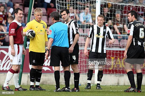 Referee Andy D'Urso talks to Steve Guinan of Northampton Town as Kasper Schmeichel, Mike Edwards, Ricky Ravenhill and John Thompson look on during...