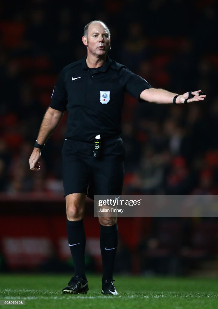 Referee Andy Haines gives a decision during the EFL Checkatrade Trophy Third Round match between Charlton Athletic and Oxford United at The Valley on January 9, 2018 in London, England.