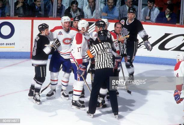 Referee Andy Van Hellemond tries to break up a confrontation between John LeClair of the Montreal Canadiens and Rob Blake of the Los Angeles Kings as...