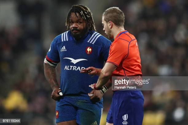 Referee Angus Gardner of Australia talks to Mathieu Bastareaud of France during the International Test match between the New Zealand All Blacks and...