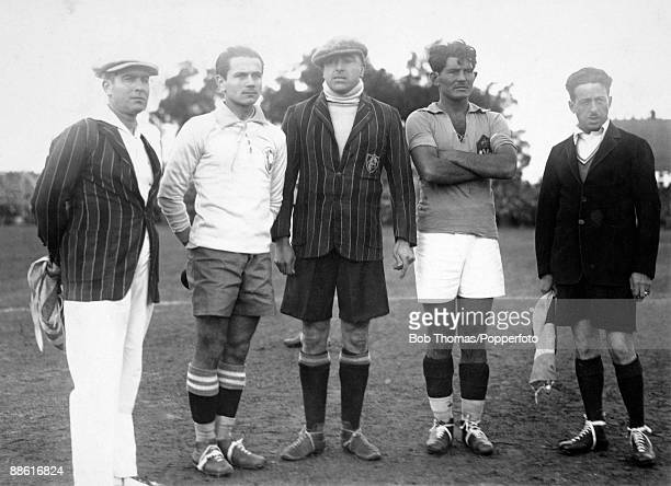 Referee Anibal Tejeda and linesmen Ricardo Vallarino and Mr Baldway line up with the captains of Brazil Jao Coelho Neto and Milutin Ivkovic of...