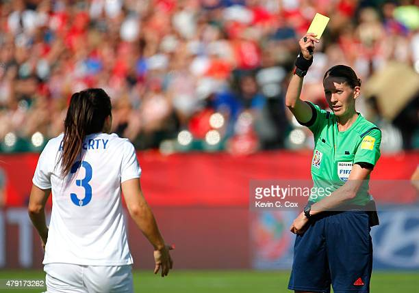 Referee AnnaMarie Keighley of New Zealand issues a yellow card to Claire Rafferty of England which resulted in a penalty kick goal by Japan during...
