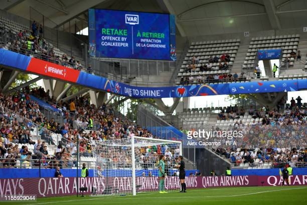 Referee AnnaMarie Keighley speaks with Sydney Scheider of Jamaica as a VAR decision results in an Italy penalty being retaken during the 2019 FIFA...