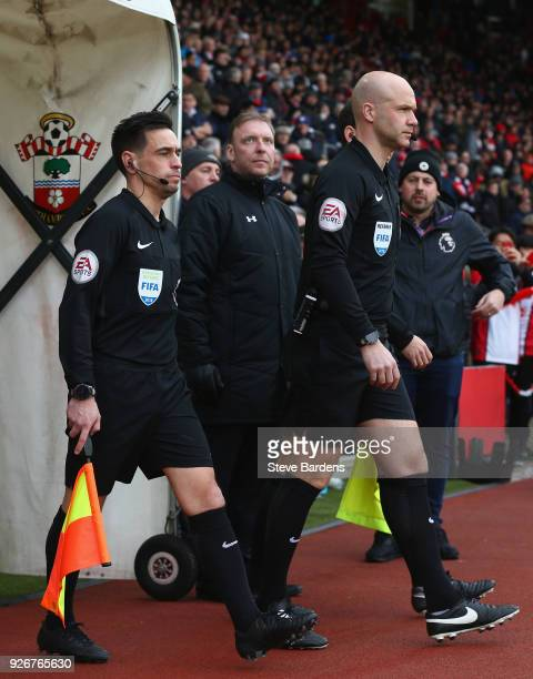 Referee Anthony Taylor and assistant referee Adam Nunn lead the teams out prior the Premier League match between Southampton and Stoke City at St...