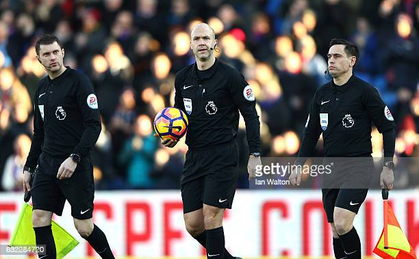 Referee Anthony Taylor and assistant referees walk onto the pitch prior to the Premier League match between Crystal Palace and Everton at Selhurst...