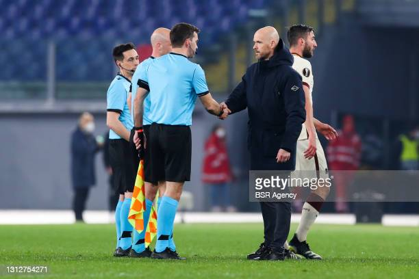 Referee Anthony Taylor and coach Erik Ten Hag of Ajax during the UEFA Europa League Quarter Final: Leg Two match between AS Roma and Ajax at Stadio...