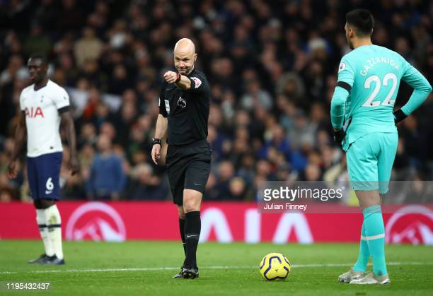 Referee Anthony Taylor awards a penaly during the Premier League match between Tottenham Hotspur and Chelsea FC at Tottenham Hotspur Stadium on...