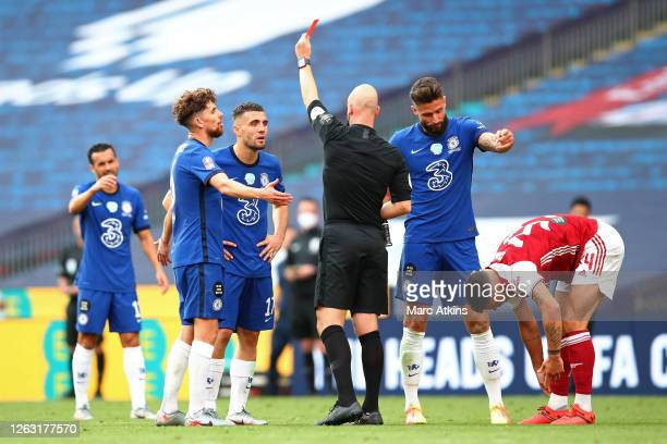 Referee Anthony Taylor awards Mateo Kovacic of Chelsea a red card, after he receives a second yellow card during the FA Cup Final match between...