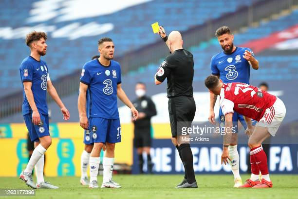 Referee Anthony Taylor awards Mateo Kovacic of Chelsea a yellow card, his second in the game, resulting in him being sent off during the FA Cup Final...