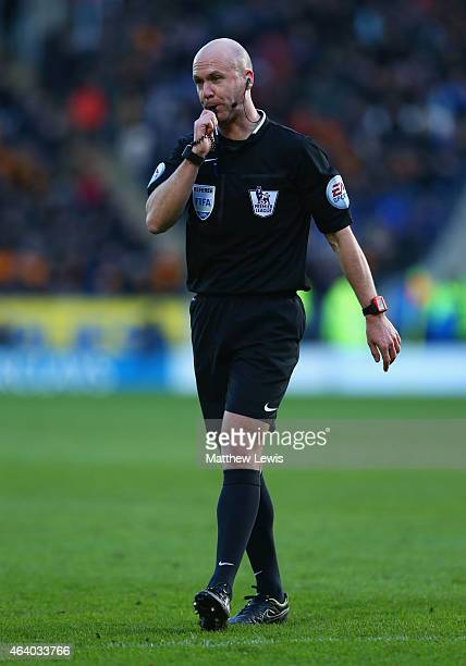 Referee Anthony Taylor blows his whistle during the Barclays Premier League match between Hull City and Queens Park Rangers at KC Stadium on February...