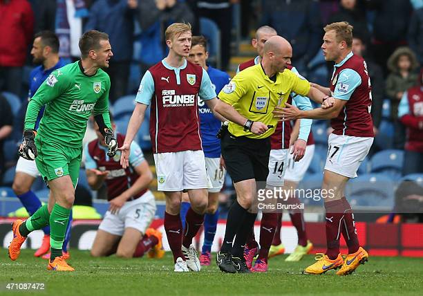 Referee Anthony Taylor comes between Thomas Heaton of Burnley and Scott Arfield of Burnley during the Barclays Premier League match between Burnley...