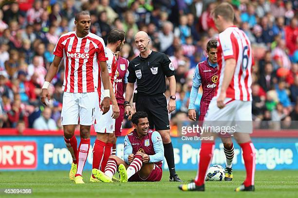 Referee Anthony Taylor during the Barclays Premier League match between Stoke City and Aston Villa at Britannia Stadium on August 16 2014 in Stoke on...