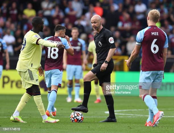 Referee Anthony Taylor during the Premier League match between Burnley and Arsenal at Turf Moor on September 18, 2021 in Burnley, England.