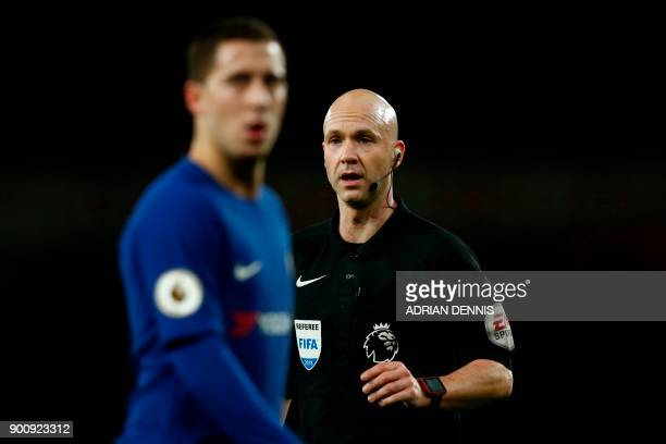 Referee Anthony Taylor follows the game during the English Premier League football match between Arsenal and Chelsea at the Emirates Stadium in...