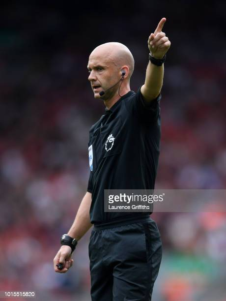 Referee Anthony Taylor gestures during the Premier League match between Liverpool FC and West Ham United at Anfield on August 12 2018 in Liverpool...