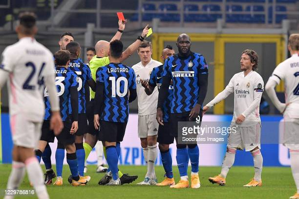 Referee Anthony Taylor gives a red card to Arturo Vidal of Internazionale during the UEFA Champions League match between Internazionale v Real Madrid...