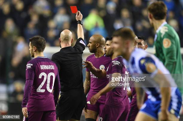 Referee Anthony Taylor gives a red card to Manchester City's English midfielder Fabian Delph during the English FA Cup fifth round football match...