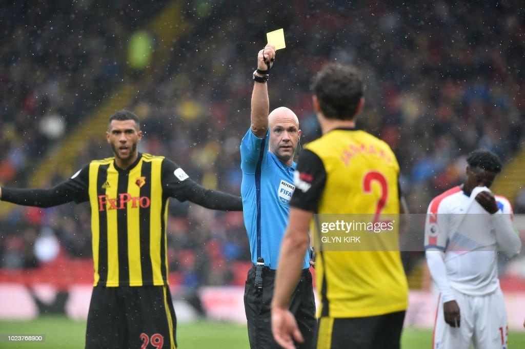 Referee Anthony Taylor Hands Watford's Dutch Defender