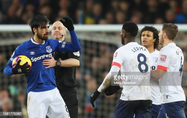 Referee Anthony Taylor intervenes as Andre Gomes of Everton clashes with Bournemouth players during the Premier League match between Everton FC and...