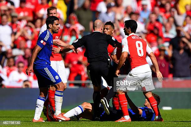 Referee Anthony Taylor intervenes between Radamel Falcao Garcia of Chelsea and Mikel Arteta of Arsenal during the FA Community Shield match between...