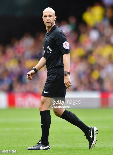 Referee Anthony Taylor looks on during the Premier League match between Watford and Liverpool at Vicarage Road on August 12 2017 in Watford England