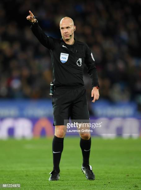 Referee Anthony Taylor points during the Premier League match between Leicester City and Tottenham Hotspur at The King Power Stadium on November 28...